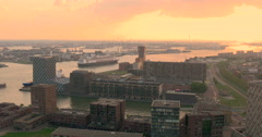 Rotterdam port harbor harbour canal river aerial view Netherlands sun set Stock Footage