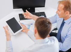 Businessmen with notebook and tablet pc Stock Photos