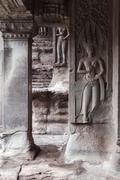 Bas-relief on the wall of Angkor Wat Temple, Cambodia. - stock photo