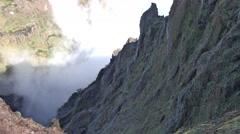 4k Clouds in mountain valley tilt up Pico do Arieiro Madeira Stock Footage