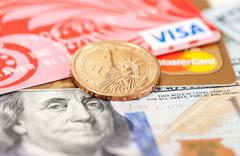 Photo of VISA and Mastercard credit card with american dollars - stock photo