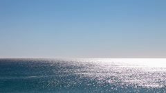 The Atlantic Ocean water shimmering and glittering on a calm summer day Stock Footage