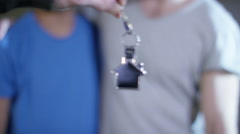 4K Happy affectionate gay male couple take the key to their new home Stock Footage
