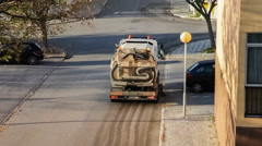 A street sweeper or street cleaner cleaning the curbs - stock footage
