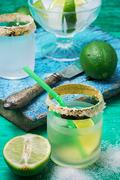 Refreshing cocktail made of rum and lime with ice Stock Photos