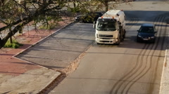 A street sweeper or street cleaner cleaning the curbs Stock Footage