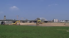 Lowering, excavating a part of the floodplains, Deventer Bridge in background Stock Footage