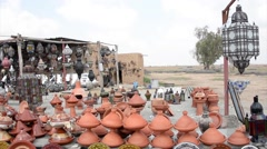 A huge load of handcraft in the yard of a shop in the outskirts of Marrakech - stock footage