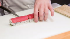 Asian chef cutting appetizing sushi rolls Stock Footage