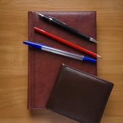 Pen, pencil and notebook on the wood table Stock Photos