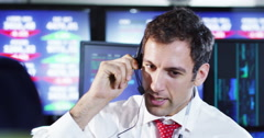 4K Portrait of city stockmarket trader, at work in a chaotic trading room Stock Footage