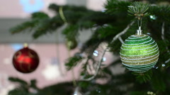 Woman hang decorative toy ball on Christmas tree branch Stock Footage
