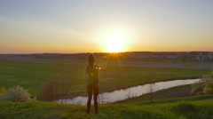 Woman hold paper airplane and launch by the bright sun and picturesque landscap Stock Footage