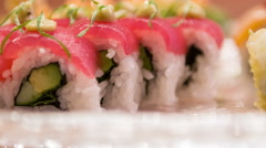 Different delicious rolls lying in big plate Stock Footage