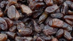 Wasps in a heap of dates in Marrakech, Morocco - stock footage