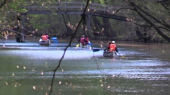 Canoeing downstream on the mill stream in Frederiksdal, Denmark Stock Footage
