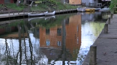 Canoe and rowboat rental at the old water mill, weir and passage Stock Footage