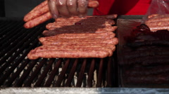 Hand putting sausages on grill, barbecue, meat, unhealthy food Stock Footage