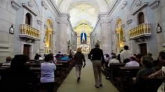 Faithful praying inside Sao Bento da Porta Aberta Sanctuary. Portugal - stock footage