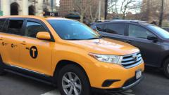 Yellow cab crossing the road in NY Stock Footage