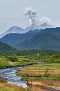 Mountain landscape: eruption Zhupanovsky Volcano on Kamchatka Stock Photos