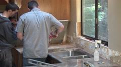 Men installing granite counter tops Stock Footage