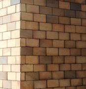 The corner of a brick wall - stock photo