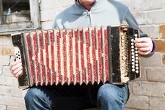man playing concertina - stock photo