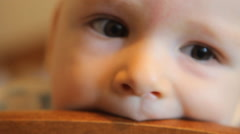Baby chewing on the headboard Stock Footage