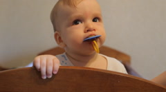 Baby with a pacifier in his mouth is back in the crib Stock Footage