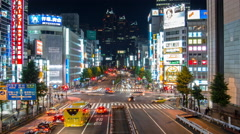 Zoom out time lapse of busy street near Shinjuku Station Stock Footage