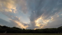 Time lapse of clouds passing overhead at sunset in Yoyogi park in Tokyo Stock Footage