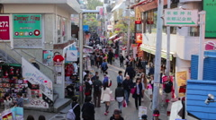Shoppers strolling on Takeshita street in Harajuku during the day Stock Footage