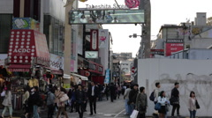 Shoppers enter Takeshita street in Harajuku from the south entrance Stock Footage