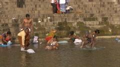 India, varanasi, people bathing in ganges river Stock Footage
