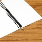 Notebook and pencil Stock Photos