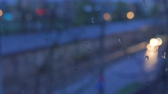 Abstract blurs of lights and rain drops through the window Stock Footage