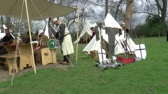 A knight is demonstrating armor  at a  fair in  Middle Ages style Stock Footage