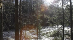 Pan along a gushing whitewater river in spring Stock Footage