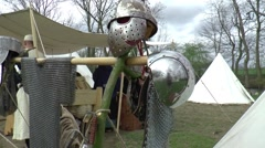 Selling armor  at a  fair in  Middle Ages style Stock Footage