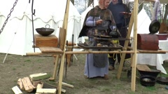 A man is preparing food at a  fair in  Middle Ages style Stock Footage