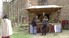 Sales stall with customers at A fair in  Middle Ages style Stock Footage