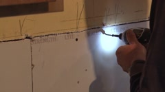 Installing dry wall Stock Footage