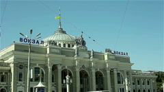 Outside Railway Station Building, Odessa, with Ukrainian Flag. City Life Stock Footage