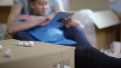 4K Happy young gay couple with computer tablet, moving into new home Stock Footage