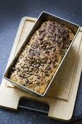 Organic, home made bread freshly baked with lots of seeds, close up - stock photo