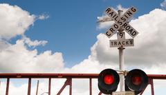 Train Passing Railroad Crossing Warning Lights Flashing - stock photo
