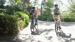 Senior couple riding bikes on trail - stock footage