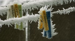 Frozen Clothespins, frost, close up Stock Footage