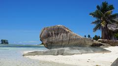 bizarre granite rocks on tropical beachon la digue Stock Photos